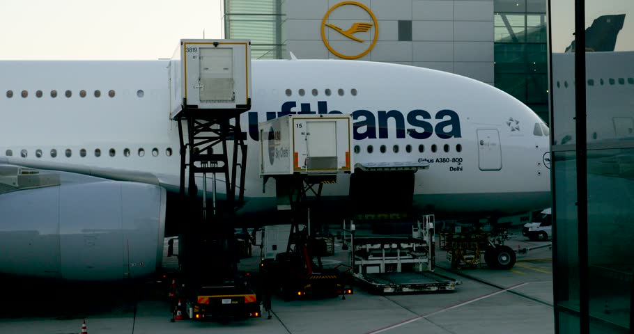 MUNICH, GERMANY - CIRCA 2017: Airport handling Crew people preparing Airbus A380-800 aircraft operated by Lufthansa at the Frankfurt International Airport. The Airbus A380-800 is the world's biggest