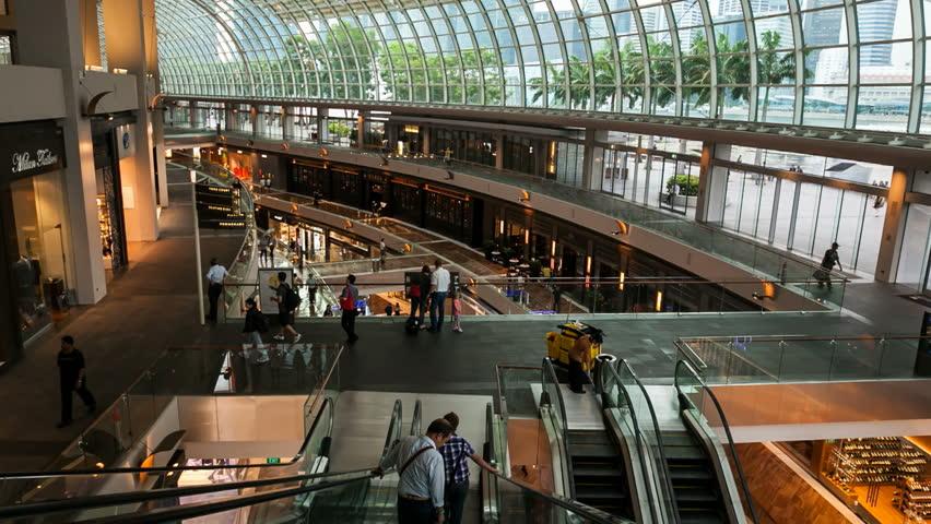SINGAPORE - 12 OCTOBER 2012: Motion Timelapse of people talking escalators in