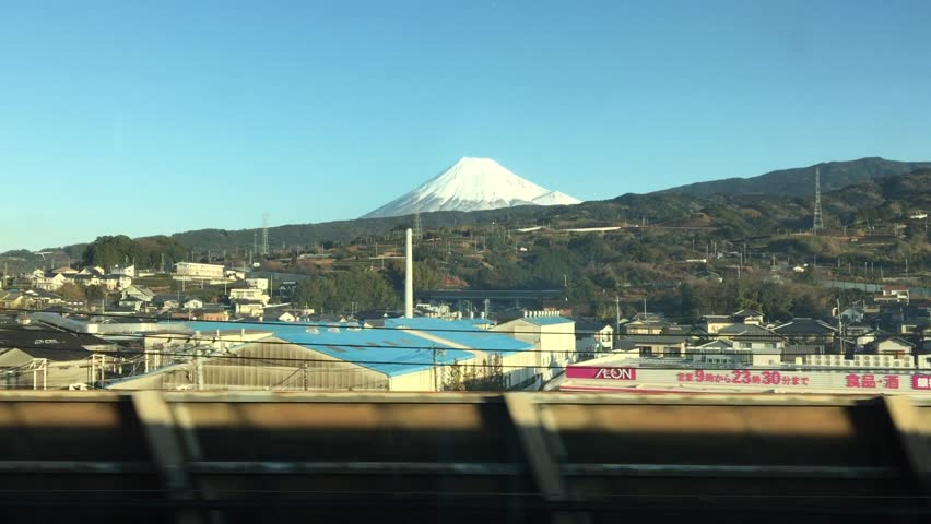 Travel on Shinkansen train on speed 320 km/h. View on Fuji mountain. Bullet Train - Symbol of Modern Japan. The Shinkansen Bullet Train. Travel in Japan from Tokyo to Osaka or Kioto. Japan Railways