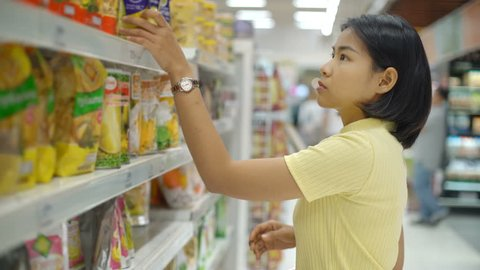 Young Asian Woman buying food in grocery department 4k UHD (3840x2160)