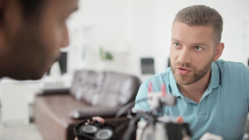 Portrait of young engineer talking to his colleague   Shutterstock HD Video #29159662