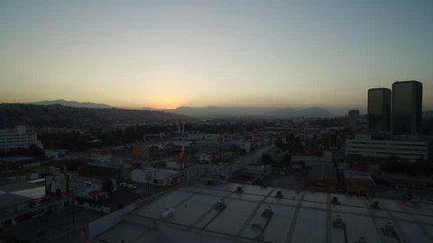 Aerial view of street traffic and residential neighborhood at dusk – Tijuana, Baja California, Mexico