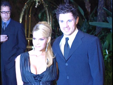Beverly Hills, CA - FEBRUARY 07, 2004: Jessica Simpson, Nick Lachey, walks the red carpet at the Clive Davis Pre Grammy Party 2004 held at the Beverly Hills Hotel