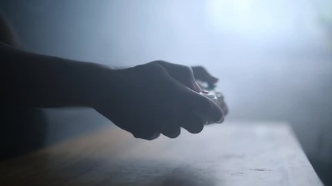 Silhouetted Male Hands Playing Video Games