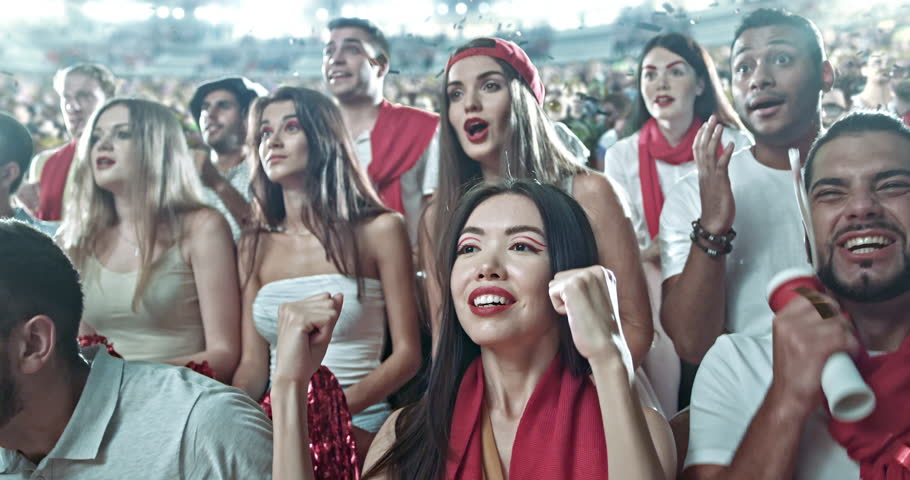 Group of fans watch a sport championship on stadium. People are dressed in casual cloth. | Shutterstock HD Video #29180893