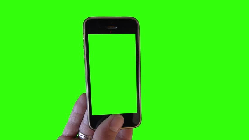 Showing Phone On Green Screen. Hand holding a green screen smartphone over a green screen background #29289643