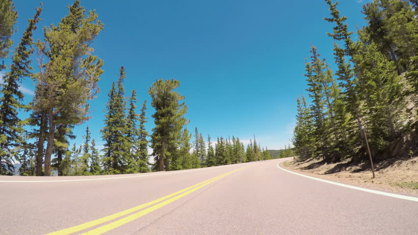 Denver, Colorado, USA-June 10, 2017.  POV point of view -  Driving on mountain highway in the Summer.