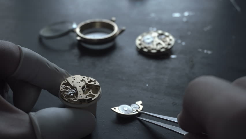 Watch maker is repairing a vintage mechanical watches