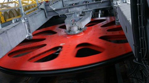 Rotating red flywheel on ropeway mashine room