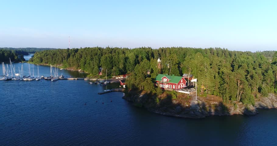 Barosund, Cinema 4k aerial sideway view towards baronsalmi guest harbor, at a evening, in finnish archipelago of Inkoo, Uusimaa, Finland - 4K stock footage clip