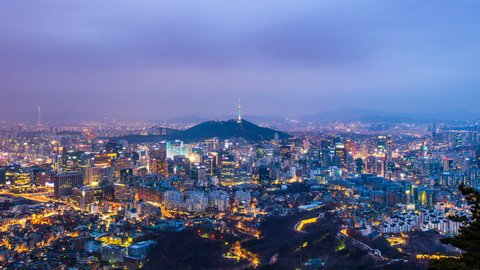 Time lapse day to night skyline of Seoul with Seoul tower, South Korea. Zoom in.