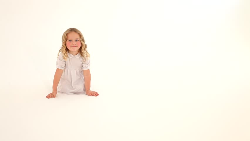 Toddler Baby Child Girl Rosy Cheeks Blond Curly Hair White Dress Sitting Drawing Heart Fingers On
