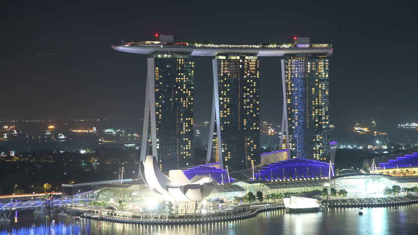 EL: Marina – Singapore January 9 2012: Time Lapse Singapore at Night. View to Marina Sands Resort in Singapore on January 9 2012