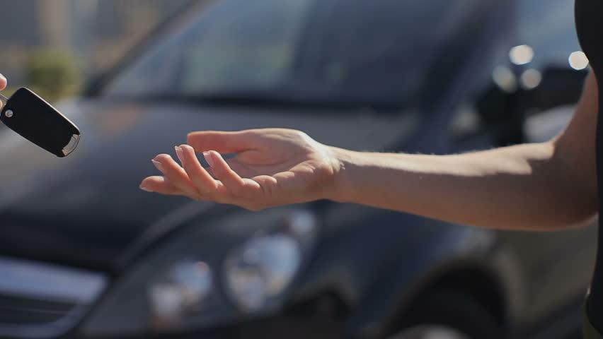 Woman getting new car keys. | Shutterstock HD Video #29396653