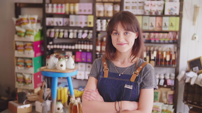 Smiling Female Deli Owner Standing Arms Crossed In Delicatessen | Shutterstock HD Video #29402263