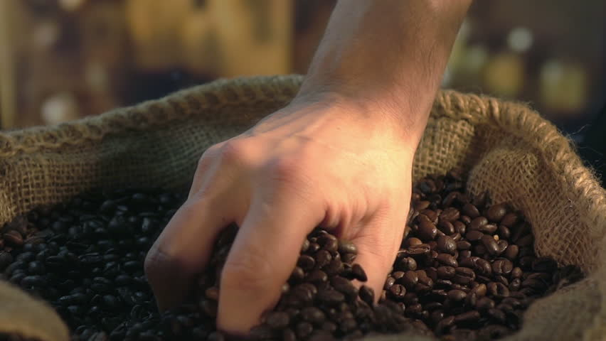 Taking coffee beans, slow motion 250fps