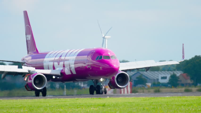 AMSTERDAM, THE NETHERLANDS - JULY 26, 2017: WOW Air Airbus 321 TF-JOY braking after landing on runway 18R Polderbaan. Shiphol Airport, Amsterdam, Holland