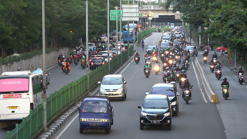 JAKARTA, INDONESIA - APRIL 2017: Motorbikes and other traffic go through the streets of central Jakarta, Indonesia