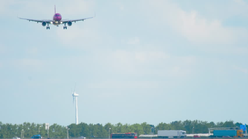 AMSTERDAM, THE NETHERLANDS - JULY 26, 2017: WOW Air Airbus 321 TF-JOY approaching before landing on runway 18R Polderbaan. Shiphol Airport, Amsterdam, Holland