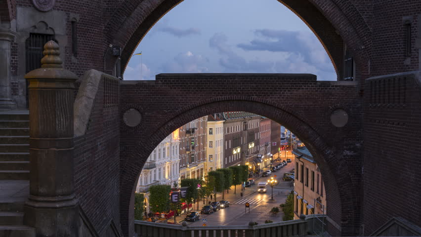 Timelapse view through an archway of the swedish city of Helsingborg. 4K, 25p