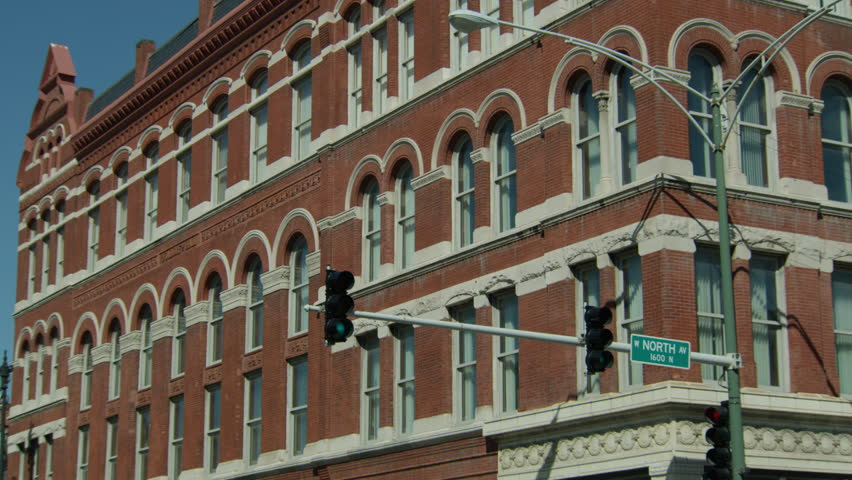 Day Hold up windows corner small 4 story red brick building office building  lofts apartment buildingDay Hold Up Small 4 Story Red Brick Building Office Building Lofts  . Brick Apartment Building Entrance. Home Design Ideas