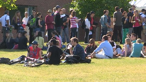 Waterloo, Ontario, Canada August 2012 Solar eclipse on college campus and students with telescopes