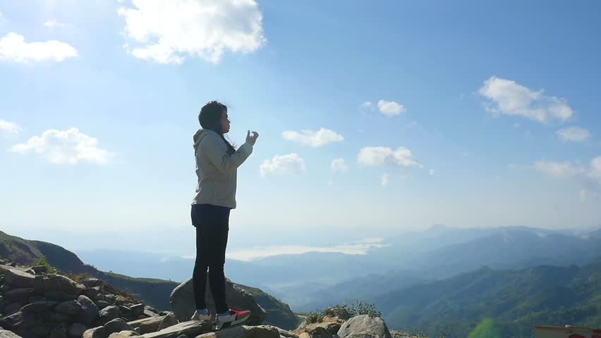 Asian woman hiker at mountain peak | Shutterstock HD Video #29587873