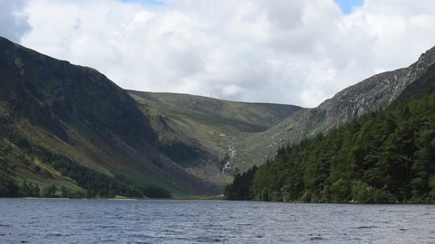 """Glendalough """"Valley of the Two Lakes"""" in Wicklow Mountains - Ireland/ Glendalough/ Glendalough Lake in the forest in Ireland"""