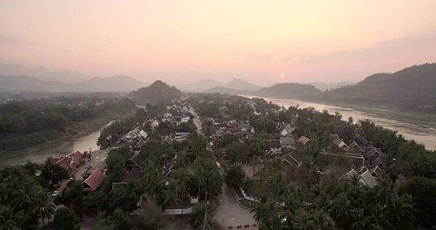 Old Historical City of Luang Prabang, Laos, at Sunset, Ascending Drone shot