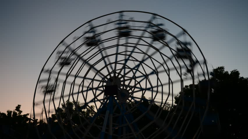 BAGAN, MYANMAR - OCTOBER 20: Time lapse of man-powered ferris wheel during 'festival of lights', at Aye Nyein Tharyar Park, Bagan on October 20, 2012 in Bagan, Myanmar