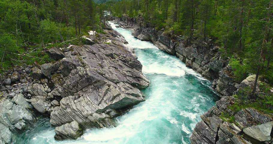 AERIAL: Flying over mountain river. Hordaland, Norway.