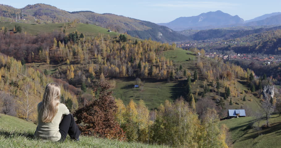 Tired Tourist Woman Rest Sitting On Mountain Hill, Girl Thinking And Admire Rural Village