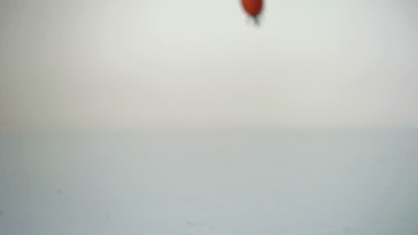 Tomato falling on glass surface, slow motion shot at 480fps  | Shutterstock HD Video #2978803