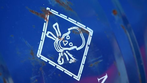 White Warning Sign with Skull and Methanol danger sign and methanol special marks at blue can
