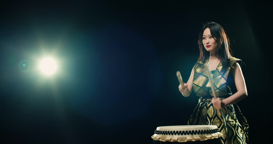 epic performance beautiful Asian girl drummer Taiko , concert light, Slow motion