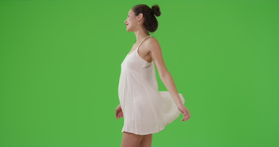 A Latina girl spins in her sundress on green screen. On green screen to be keyed or composited. | Shutterstock HD Video #29817613