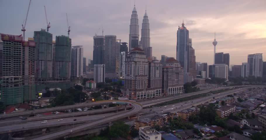Sunset Over Kuala Lumpur City Skyline at Dusk, Malaysia, Aerial Drone Footage | Shutterstock HD Video #29825083