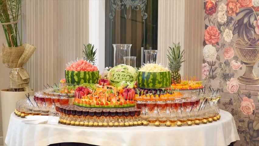 Different fresh fruits on wedding buffet table fruits and berries different fresh fruits on wedding buffet table fruits and berries wedding table decoration buffet reception fruit wines champagne watchthetrailerfo