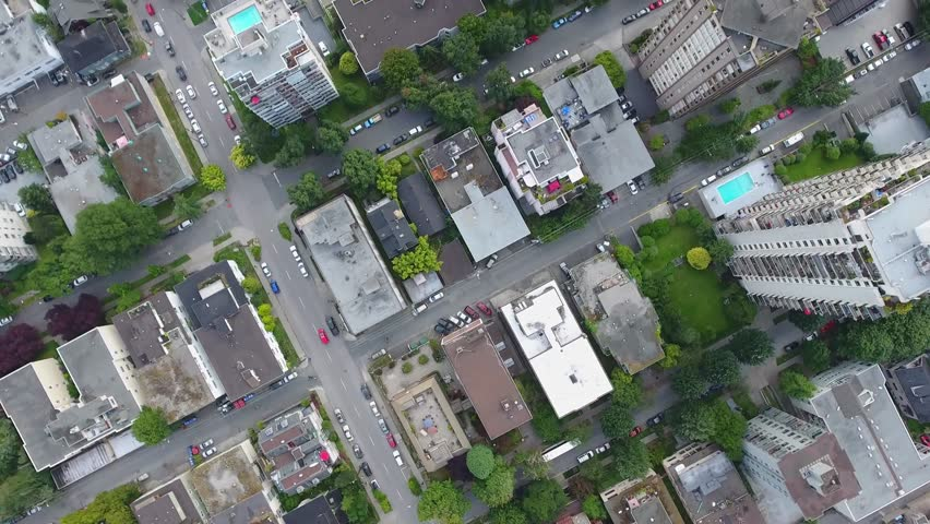 Stunning top bird eye 4k aerial drone view on Vancouver modern architecture skyscraper downtown roads cityscape skyline