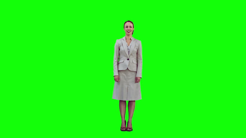 Smiling woman in slow motion raising her arms against a green background