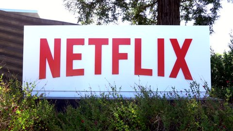 LOS GATOS, CA/USA - JULY 29, 2017: Netflix corporate headquarters and logo. Netflix specializes in and provides streaming media and video-on-demand online and DVD by mail.