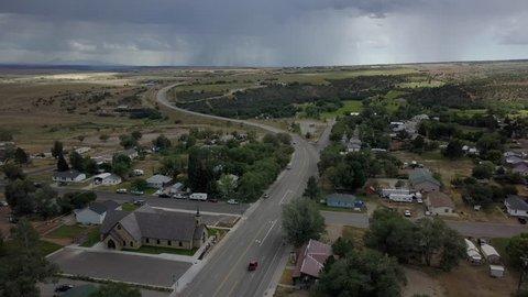 MONTICELLO, UTAH - 24 JUL 2017: Aerial rural town church highway Monticello southern Utah. Business center of town thunderstorm rain on horizon. Rural community southern Utah, San Juan County.