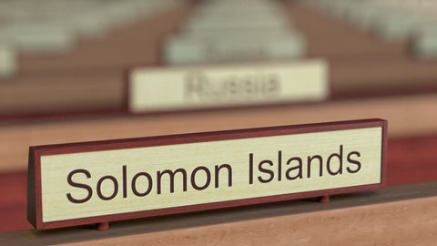 Solomon Islands name sign among different countries plaques at international organization. 3D rendering