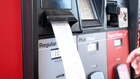 Port Coquitlam, BC, Canada - August 17, 2017: Motion of woman taking receipt at Petro Canada gas station with 4k resolution