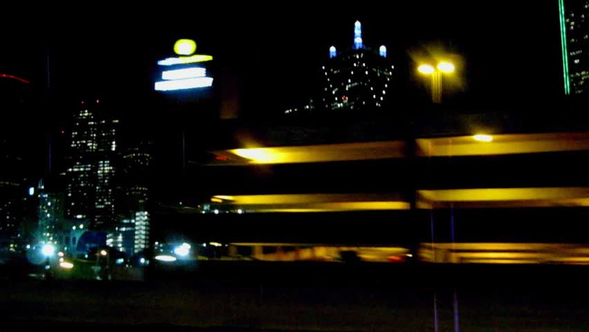 Nightlights of Downtown Dallas from driving car