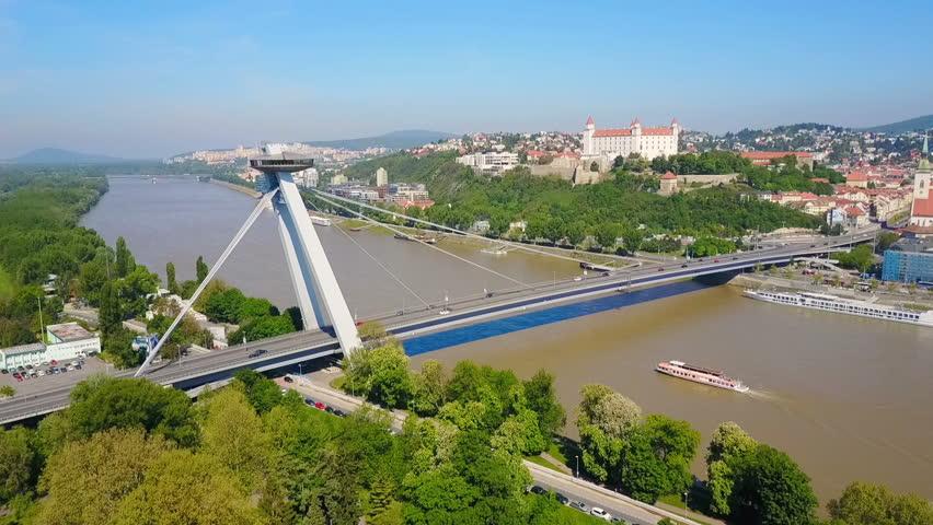 Most SNP new bridge or UFO Bridge or Novy Most aerial panoramic view in Bratislava, Slovakia. SNP Bridge is a road bridge over the Danube river.