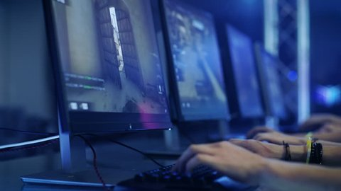 TALLINN, ESTONIA - JULY 20 2017: Close-up On Gamer's Hands on a Keyborad Playing Counter-Strike: Global Offensive. Shot on RED EPIC-W 8K Helium Cinema Camera.