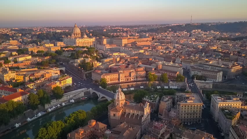 Rome aerial view at sunrise flying over vatican city