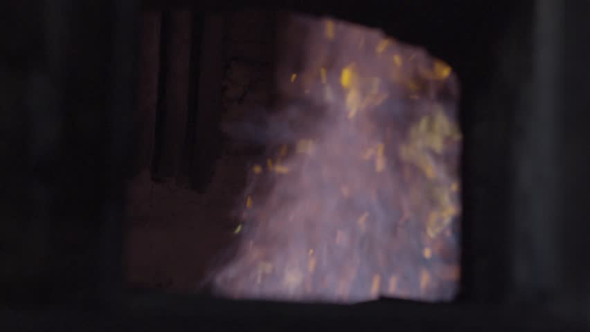 Open iron stove in boiler room. Fire inside the furnace at the plant #30072739