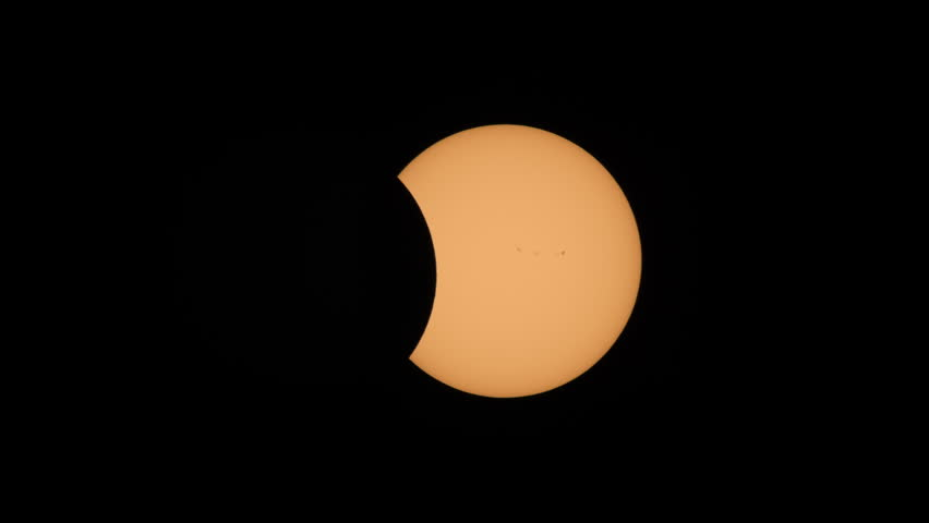 The Moon continues to pass the Sun's disk in the second partial eclipse phase of the Great American Eclipse on August 21, 2017.  Sunspots are visible on the sun's surface. #30076039